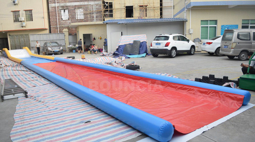 27m Long Air Sealed Inflatable Water Slides For Lakeside / Inflatable Slip N Slide ผู้ผลิต