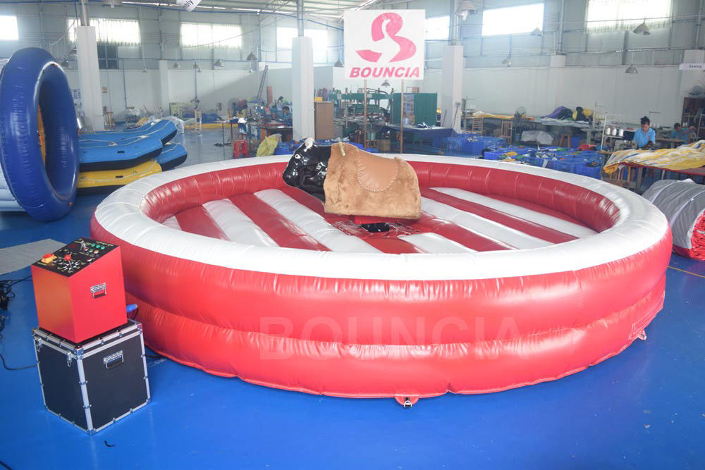 Inflatable Bull Riding Machine / Inflatable Mechanical Bull For Amusement Park ผู้ผลิต