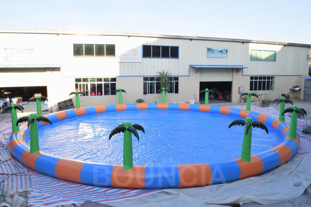 Commercial 15m Diameter Round Inflatable Water Swimming Pools With Palm Tree ผู้ผลิต